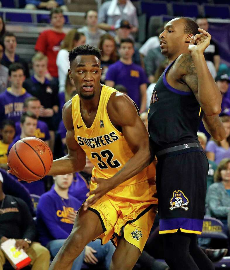 Wichita State's Markis McDuffie (32) drives the ball around East Carolina's Kentrell Barkley (15) during the second half of an NCAA college basketball game in Greenville, N.C., Thursday, Jan. 11, 2018. (AP Photo/Karl B DeBlaker) Photo: Karl B DeBlaker / FR7226 AP
