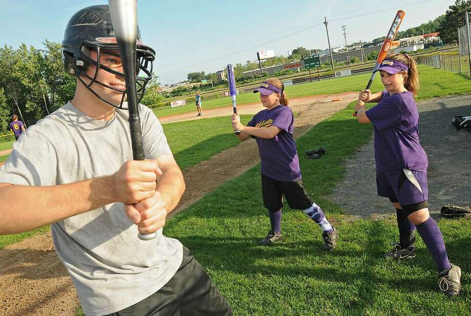 Times Union reporter Pete Iorizzo, left, gets some pointers from 12-year-old Jessica Ricciardi, center, of Colonie, and Kaylee Noll, 13, of Colonie. (Lori Van Buren / Times Union) Photo: LORI VAN BUREN