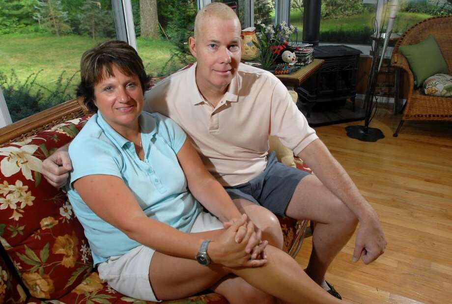 Gina Peca and her husband, Larry Hoch, sit together at their home on Thursday, Aug. 27, 2009, in Clifton Park. (Cindy Schultz / Times Union) Photo: CINDY SCHULTZ / 00005160A