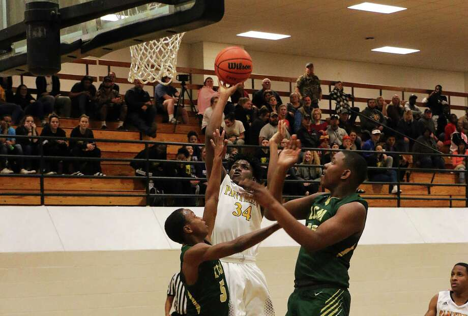 Kevin Williams goes up over a Little Cypress-Mauriceville defender to score two points for the Panthers in their non-conference match against the Bears last Tuesday night. Photo: David Taylor