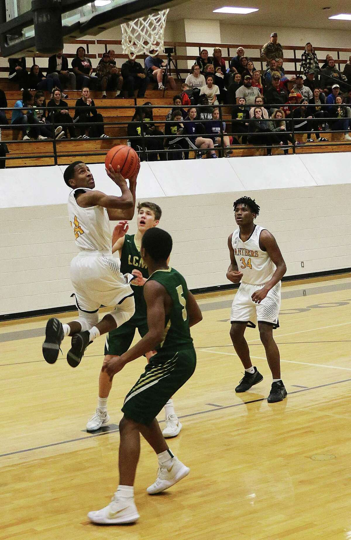Feet off the floor and in mid-air, Heath Brown turns toward the basket for a shot in TuesdayÂ?'s game against Little Cypress-Mauriceville.