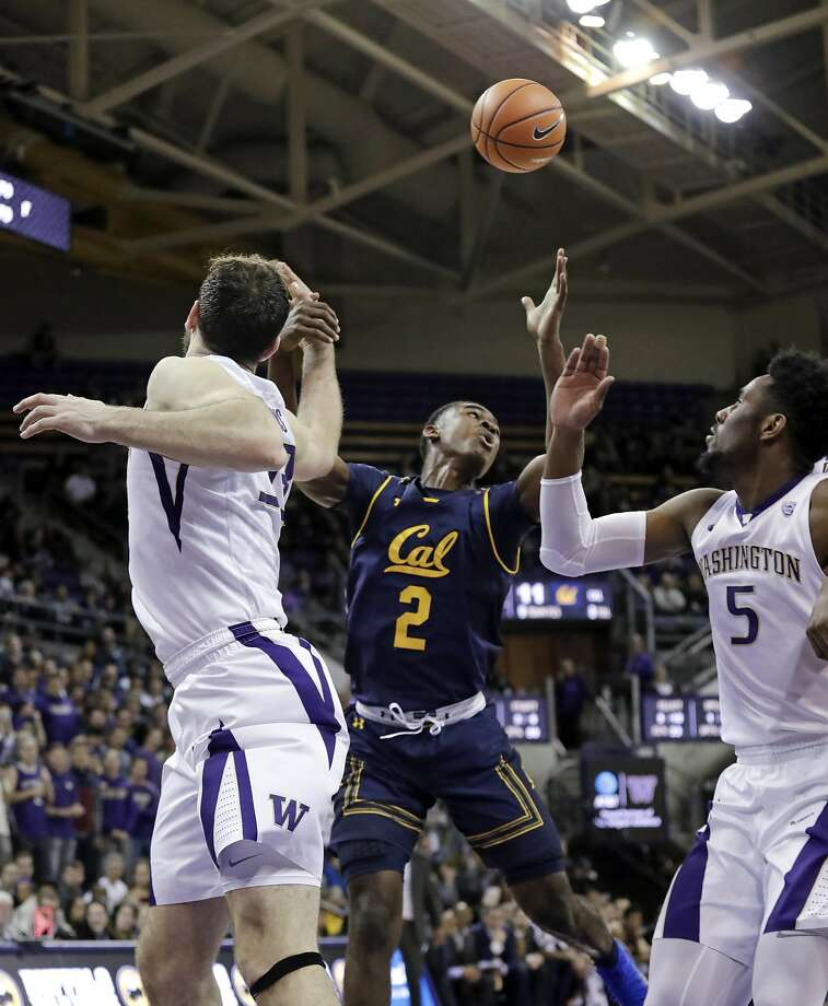 California's Juhwan Harris-Dyson (2) and Washington's Sam Timmins, left, and Jaylen Nowell eye a loose ball during the first half of an NCAA college basketball game Thursday, Jan. 11, 2018, in Seattle. (AP Photo/Elaine Thompson) Photo: Elaine Thompson, Associated Press