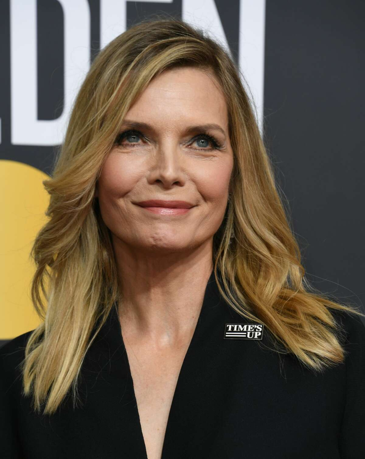 Name: Michelle Pfeiffer Born: April 29, 1958 (Photo credit should read VALERIE MACON/AFP/Getty Images)