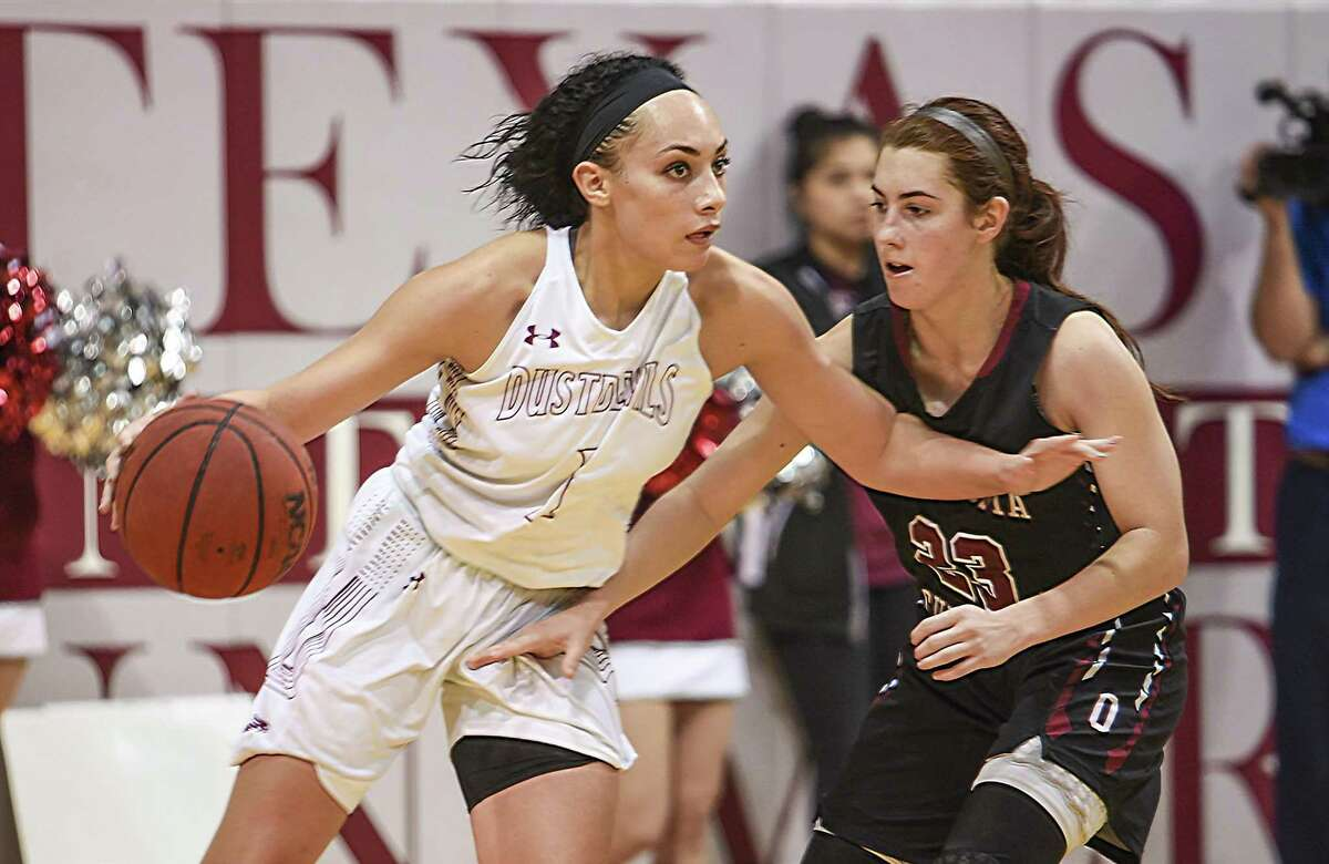 Texas A& International University Tantashea Giger moves the ball down the court during a game against Oklahoma Christian University on Jan. 11, 2018, at the TAMIU KCB.