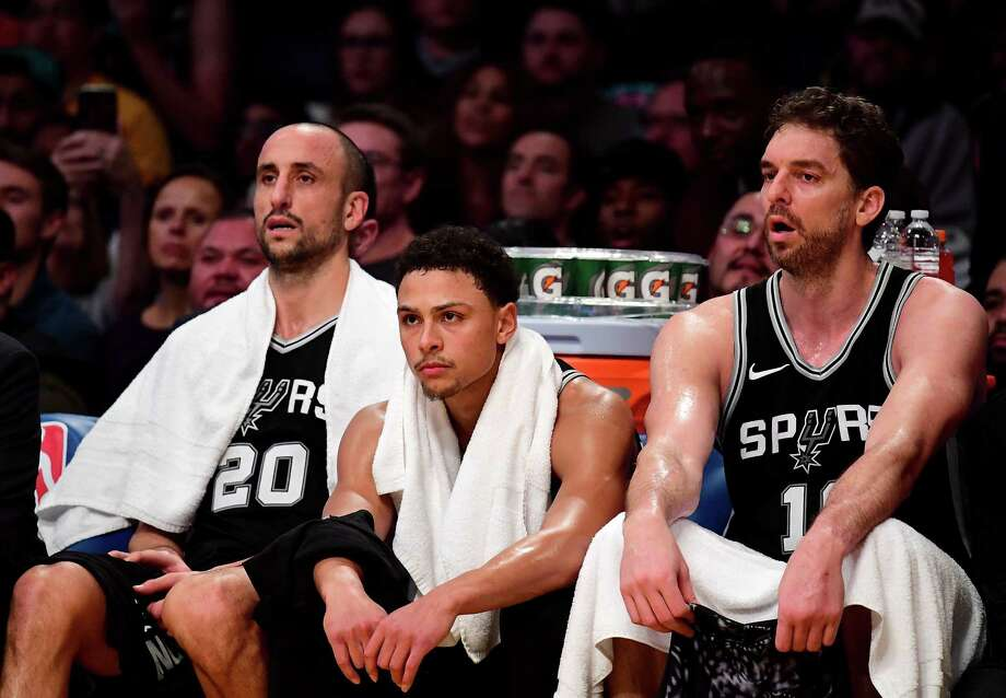 LOS ANGELES, CA - JANUARY 11:  (L-R)  Manu Ginobili #20, Bryn Forbes #11 and Pau Gasol #16 of the San Antonio Spurs watch during a 93-81 Los Angeles Laker win at Staples Center on January 11, 2018 in Los Angeles, California. Photo: Harry How, Getty Images / 2018 Getty Images