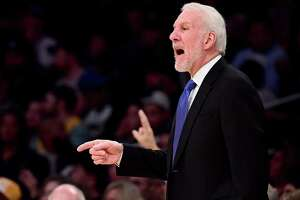 LOS ANGELES, CA - JANUARY 11:  Gregg Popovich of the San Antonio Spurs talks to his players from the sidelines during the first half against the Los Angeles Lakers at Staples Center on January 11, 2018 in Los Angeles, California.