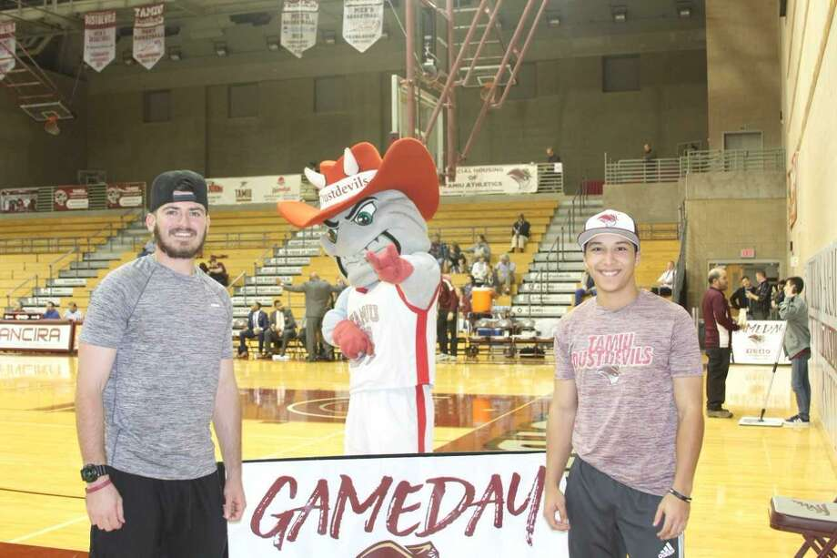 TAMIU baseball players Kyle Kieschnick, left, and Daniel Espinoza each completed the Progressive Shot contest at halftime of the Dustdevils basketball game with Oklahoma Christian Thursday night. The two both hit a layup, free throw, 3-pointer and half-court shot on back-to-back tries to potentially win a $25,000 car prize. Espinoza went first but was disqualified as a young boy passed him the ball during his allotted time giving Kieschnick the opportunity to win the car instead, and he sank all four of his shots. Kieschnick is awaiting confirmation by Interactive Promotions Group that he will be awarded the prize. Photo: Courtesy Of TAMIU Athletics