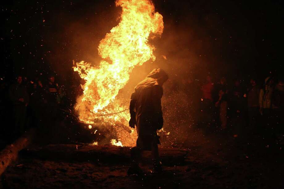 Scenes from the annual Point83 cyclist club Christmas tree burn, Thursday, Jan. 11, 2017 at Golden Gardens Beach Park. Participants bring their trees to the inferno, most via bicycle. The bonfire has become an annual tradition over the past decade. Photo: GENNA MARTIN, SEATTLEPI.COM / Seattlepi.com
