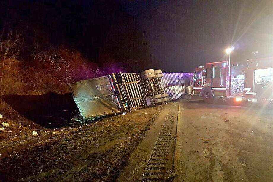 A truck carrying 45,000 lbs of raw fish flipped on I-95 in eastern Connecticut on Friday, Jan. 12, 2018. The accident forced the closure of all lanes near Exit 91 in Stonington, State Police said. The driver escaped with minor injuries. Photo: Connecticut State Police
