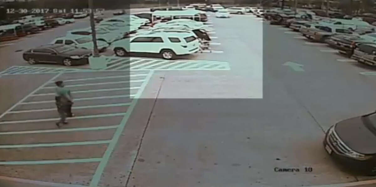 The Houston Police Department is searching for two men who were caught on surveillance video robbing a 77-year-old woman.
