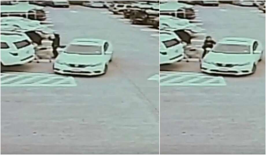 The Houston Police Department is searching for two men who were caught on surveillance video robbing a 77-year-old woman. Photo: Houston Police Department