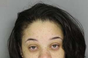 Natasha Willis, 26, was arrested and charged with possession with intent to deliver narcotics after she left a backpack full of heroin in a middle school parking lot.