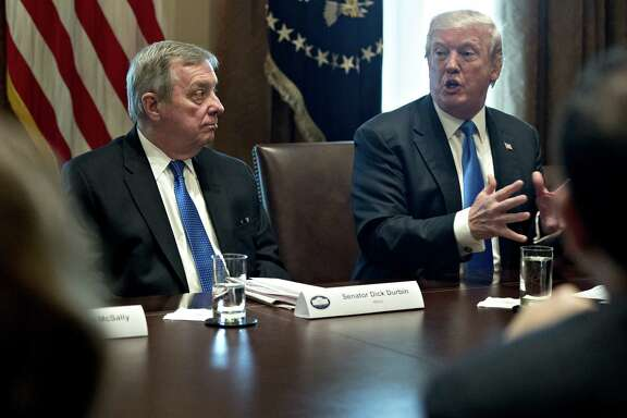President Donald Trump speaks while Sen. Dick Durbin, D-Ill.(left) listens during a meeting with bipartisan members of Congress on immigration in the Cabinet Room of the White House in Washington, on Jan. 9, 2018.