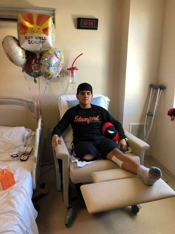 Stamford High School senior Erwin Hernandez recovers at Stamford Hospital after having his leg amputated. Photo: Marisa Young / Contributed Photo