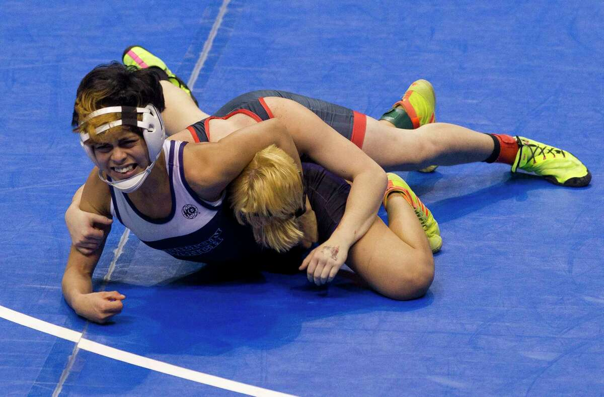 Chelsea Sanchez of Morton Ranch, left, reached the state Class 6A girls 110-pound championship final to help lead the Mavericks to their first state crown at the UIL Wrestling State Championships Saturday, Feb. 25, 2017, in Cypress.