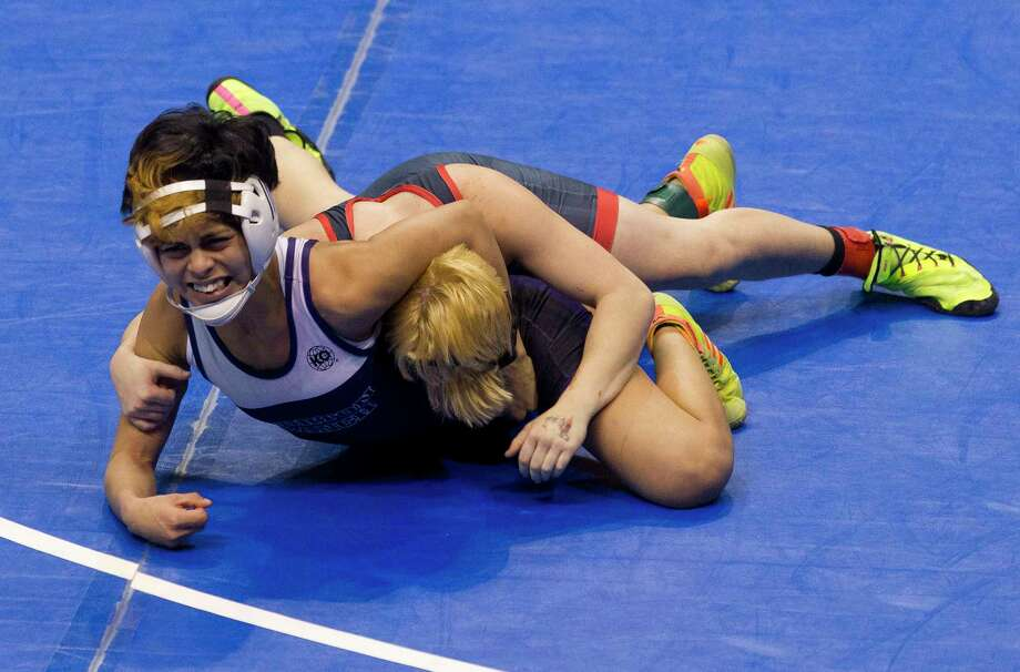 Chelsea Sanchez of Morton Ranch, left, reached the state Class 6A girls 110-pound championship final to help lead the Mavericks to their first state crown at the UIL Wrestling State Championships Saturday, Feb. 25, 2017, in Cypress. Photo: Jason Fochtman, Staff Photographer / © 2017 Houston Chronicle