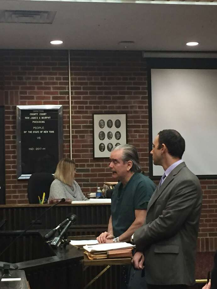 Michael C. Norton speaks as Saratoga County Judge James Murphy prepares to sentence him to 20 years to life in prison for the ax murder of his wife. Photo: Amanda Fries / Times Union