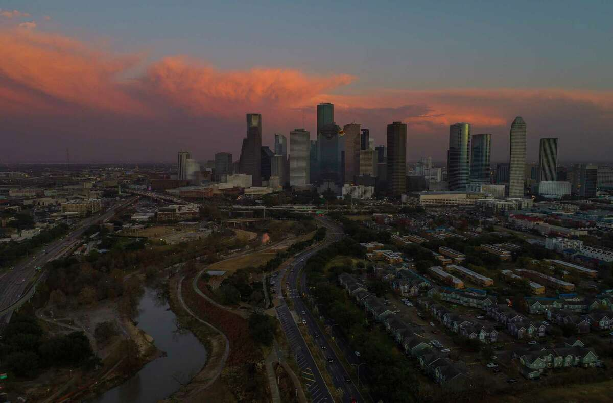 The sun sets on downtown Houston after a band of thunderstorms brought by a cold front moved across the city, Thursday, Jan. 11, 2018, in Houston.