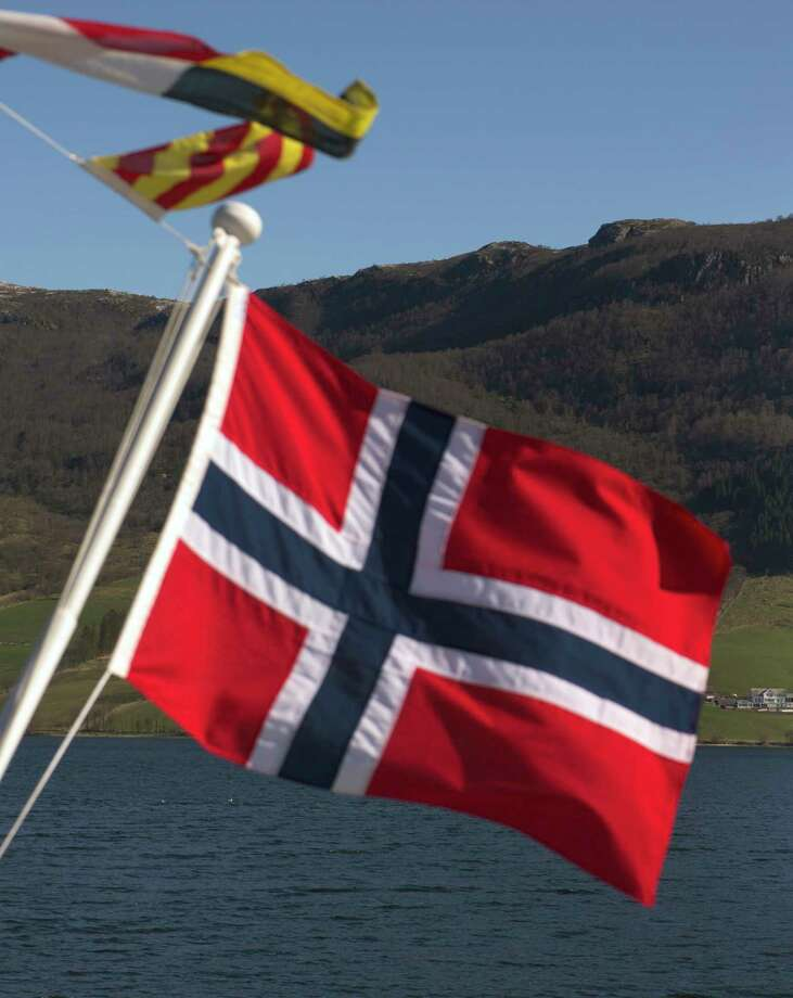 The Norwegian national flag in Olensvag, Norway, on April 3, 2012. Photo: Bloomberg Photo By Kristian Helgesen. / © 2012 Bloomberg Finance LP