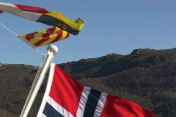 The Norwegian national flag in Olensvag, Norway, on April 3, 2012.