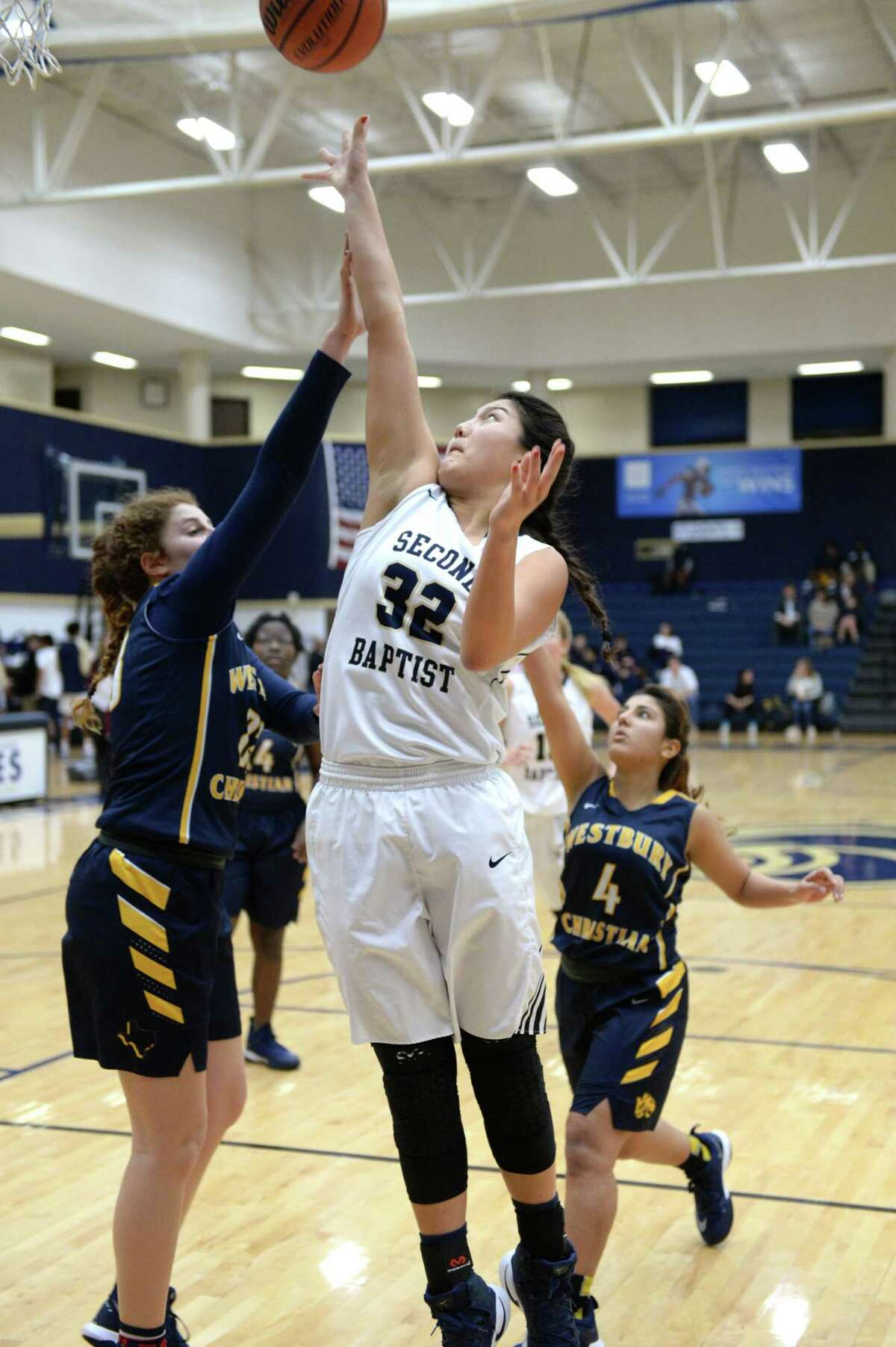 Mackenzie Kim (32) of Second Baptist attempts a shot during the second half of a varsity girls basketball game between Second Baptist Eagles and the Westbury Christian Wildcats on Tuesday January 9, 2018 at Second Baptist, Houston, TX.