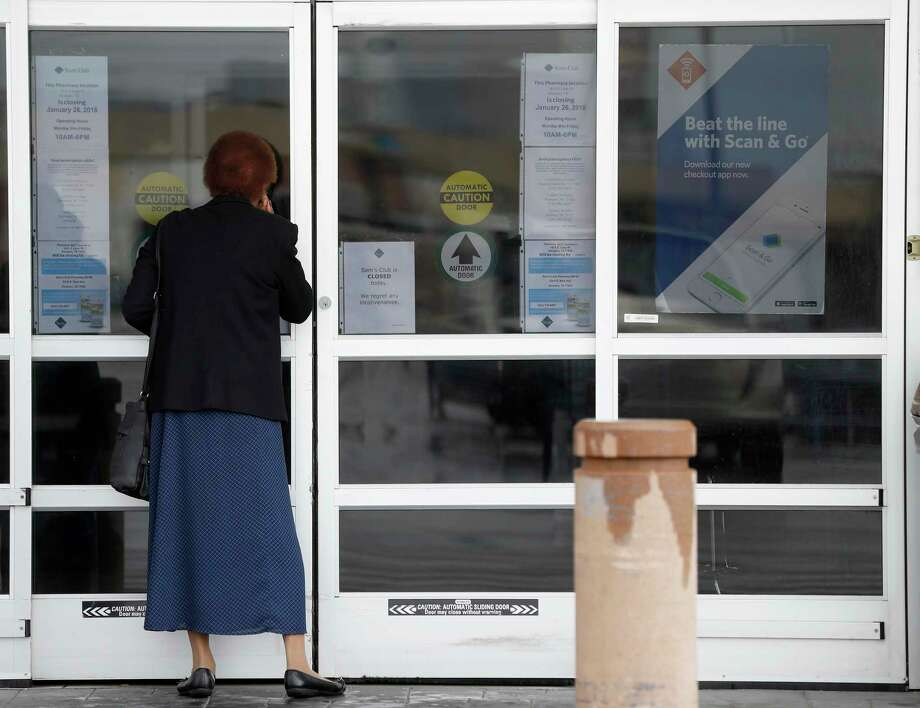 A woman looks through the doors of the Sam's Club at 1615 South Loop West, which closed it's door earlier this morning, Thursday, Jan. 11, 2018, in Houston.   ( Karen Warren / Houston Chronicle ) Photo: Karen Warren, Staff / © 2018 Houston Chronicle