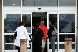 A man stops people from coming into the Sam's Club at 1615 South Loop West, which closed it's doors earlier this morning, Thursday, Jan. 11, 2018, in Houston.   ( Karen Warren / Houston Chronicle )
