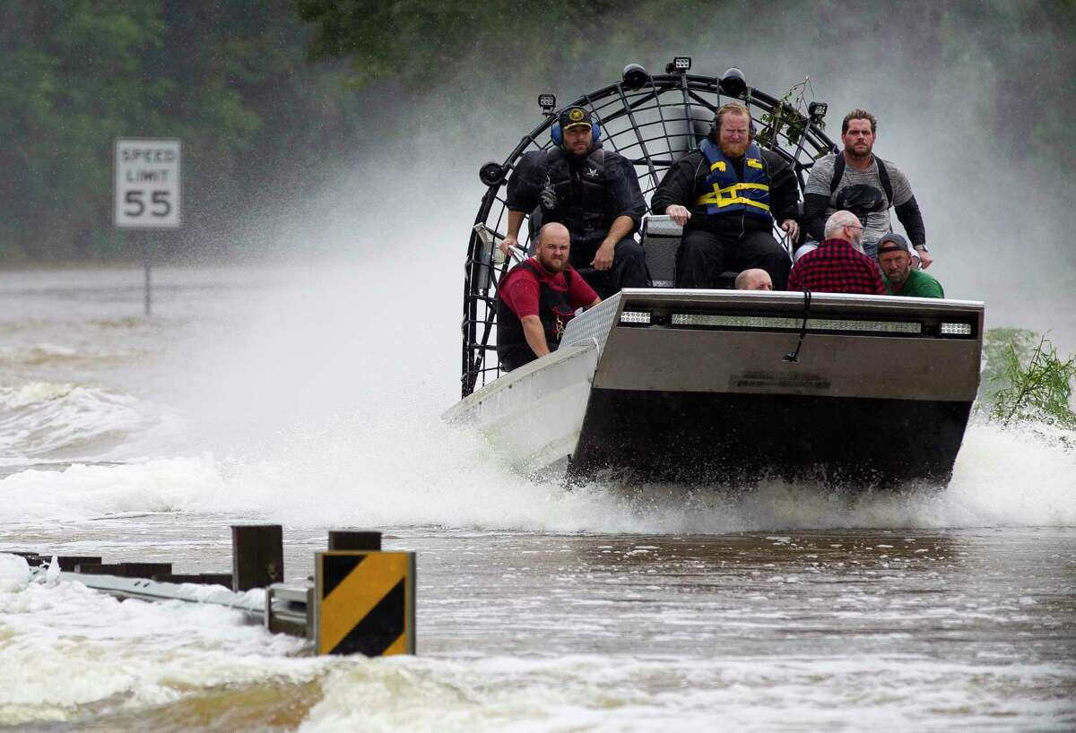 Residents are evacuated from their homes by airboat across the San Jacinto River on FM 1485, Tuesday, Aug. 29, 2017, in New Caney. Members of the Cajun Navy, a volunteer civilian group that helps those affected by disasters, helped with rescue and recovery efforts in East Montgomery County.