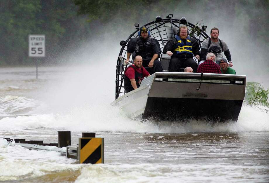 Residents are evacuated from their homes by airboat across the San Jacinto River on FM 1485, Tuesday, Aug. 29, 2017, in New Caney. Members of the Cajun Navy, a volunteer civilian group that helps those affected by disasters, helped with rescue and recovery efforts in East Montgomery County. Photo: Jason Fochtman, Staff Photographer / © 2017 Houston Chronicle