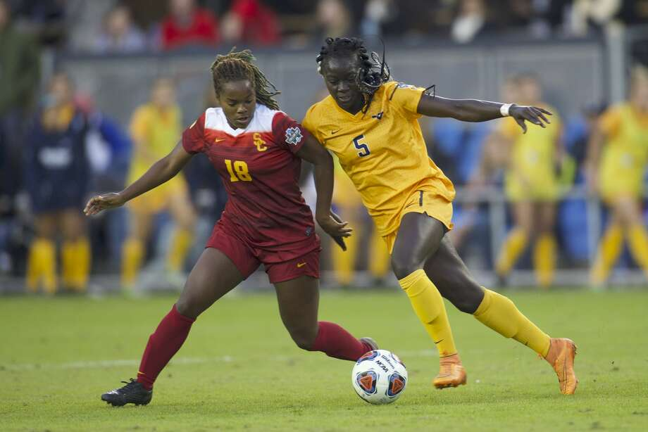 SAN JOSE, CA - DECEMBER 04:  Michaela Abam (5) of West Virginia University and Kayla Mills (18) of the University of Southern California battle for the ball during the Division I Women's Soccer Championship held at Avaya Stadium on December 04, 2016 in San Jose, California.  USC defeated West Virginia 3-1 for the national title. (Photo by Jamie Schwaberow/NCAA Photos via Getty Images) Photo: Jamie Schwaberow/NCAA Photos Via Getty Images