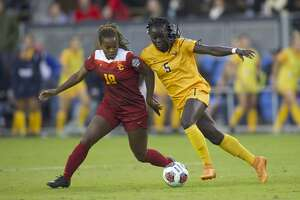 SAN JOSE, CA - DECEMBER 04:  Michaela Abam (5) of West Virginia University and Kayla Mills (18) of the University of Southern California battle for the ball during the Division I Women's Soccer Championship held at Avaya Stadium on December 04, 2016 in San Jose, California.  USC defeated West Virginia 3-1 for the national title. (Photo by Jamie Schwaberow/NCAA Photos via Getty Images)