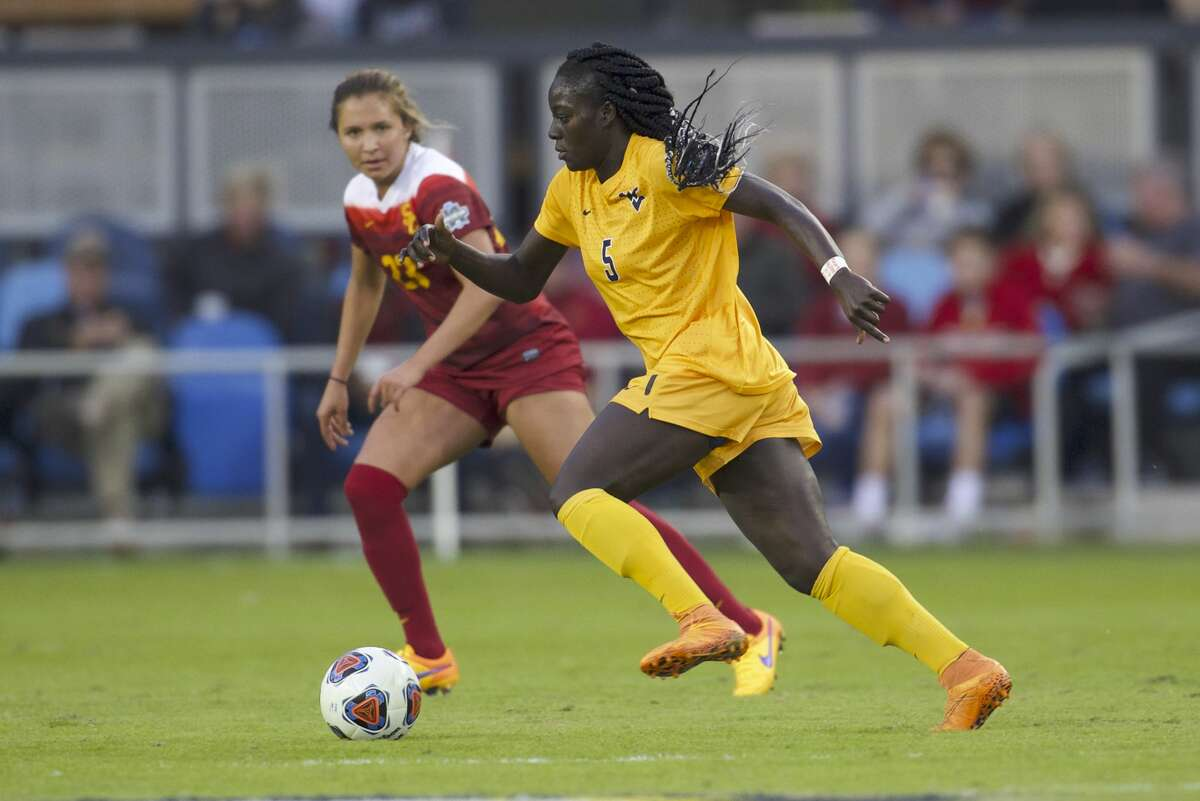 SAN JOSE, CA - DECEMBER 04: Michaela Abam (5) of West Virginia University pushes the ball upfield against the University of Southern California during the Division I Women's Soccer Championship held at Avaya Stadium on December 04, 2016 in San Jose, California. USC defeated West Virginia 3-1 for the national title. (Photo by Jamie Schwaberow/NCAA Photos via Getty Images)