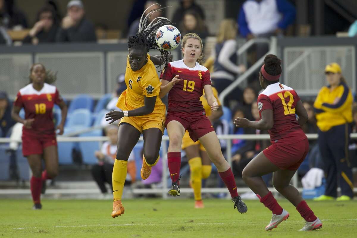 SAN JOSE, CA - DECEMBER 04: Sydney Sladek (19) of the University of Southern California and Michaela Abam (5) of West Virginia University battle for the ball during the Division I Women's Soccer Championship held at Avaya Stadium on December 04, 2016 in San Jose, California. USC defeated West Virginia 3-1 for the national title. (Photo by Jamie Schwaberow/NCAA Photos via Getty Images)