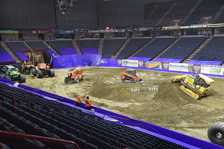 100 truckloads of dirt is dumped inside the Times Union Center for this weekend's Monster Jam on Friday, Jan. 12, 2018 in Albany, N.Y. (Lori Van Buren/Times Union) Photo: Lori Van Buren, Albany Times Union / 20042642A