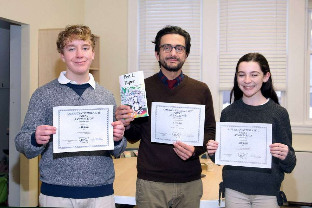 Samantha Renzulli and Ryan Cawley, both of Fairfield, received recognition for their contributions to The Unquowa School's student literary magainze. They are They are pictured with Humanities teacher and the publication?'s faculty advisor, George Seferidis.