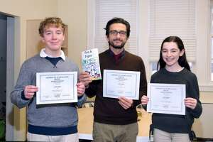 Samantha Renzulli and Ryan Cawley, both of Fairfield, received recognition for their contributions to The Unquowa School's student literary magainze. They are  They are pictured with Humanities teacher and the publication's faculty advisor, George Seferidis.