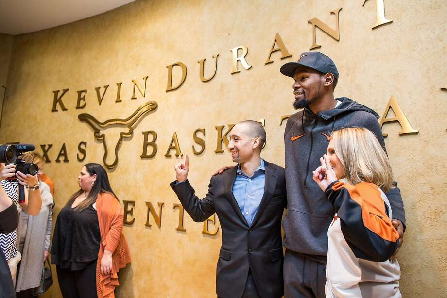 Kevin Durant poses for a photo with the head coaches of the University of Texas men's and women's basketball teams, Shaka Smart and Karen Aston, during the unveiling of the Kevin Durant Texas Basketball Center on Friday, Jan. 5, 2018 in Austin, Texas. The basketball facilities have received numerous upgrades and renovations in the past year and there are more to come with help from another $3 million donated by Durant. Photo: Tom McCarthy Jr., Special To The Chronicle