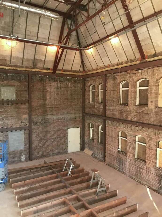 """A renovation underway inside Covenant Hall at the First Reformed Church of Schenectady removed floors that had been added in the 1950s. Timbers from the floors will be used to create a """"waffle"""" that will hang from the ceiling."""
