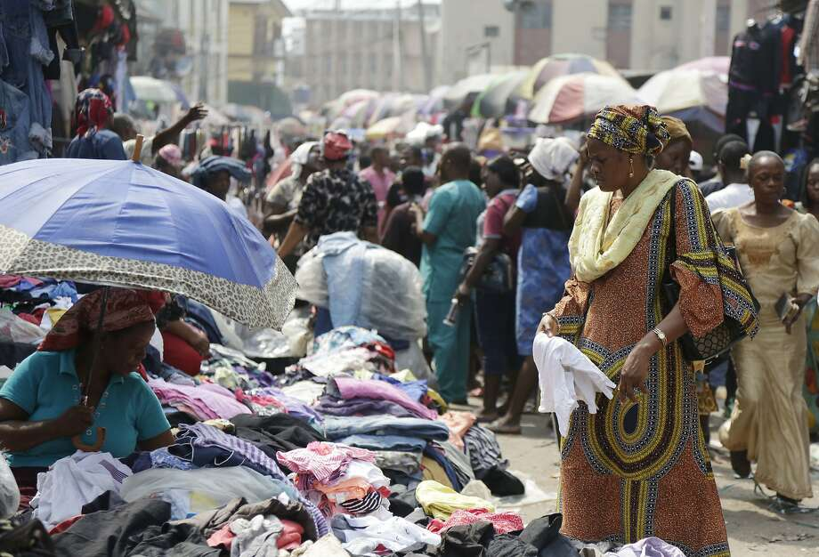 Pedestrians shop at a market in Lagos, Nigeria. While 40 percent of the world's poor live in sub-Saharan Africa, the region also has billionaires, reality shows and a growing middle class. Photo: Sunday Alamba, Associated Press