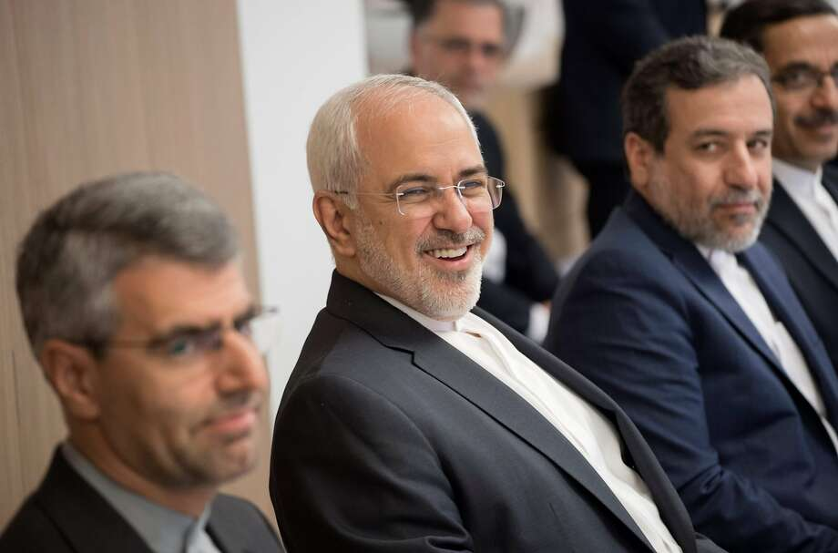 Foreign minister Mohammad Javad Zarif (center) has said Iran is not interested in any renegotiation. Photo: JOHN THYS, AFP/Getty Images