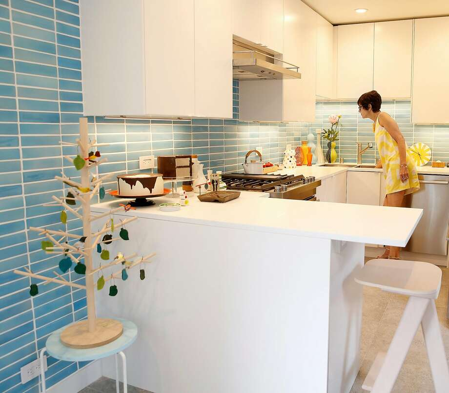 Carrie Leeb in her kitchen with blue tile. Photo: Liz Hafalia, The Chronicle