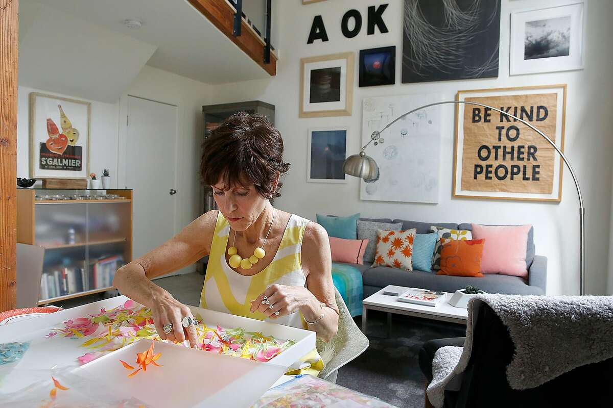 Artist and designer Carrie Leeb works on her flower art at the dining room table on Wednesday, August 23, 2017, in San Francisco, Calif.