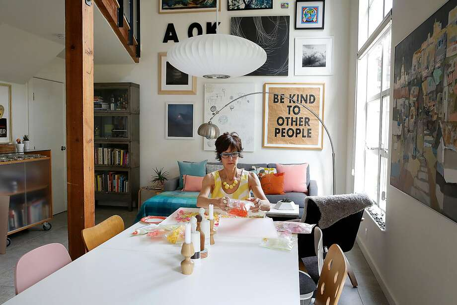Carrie Leeb at work at her dining-room table. Photo: Liz Hafalia, The Chronicle