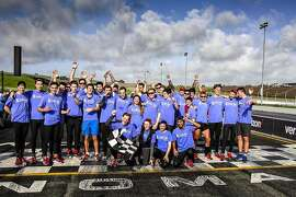 The Stanford men's rowing team gather at Sonoma Raceway after running the road course during last year's John's March, a fundraiser for stomach cancer research.