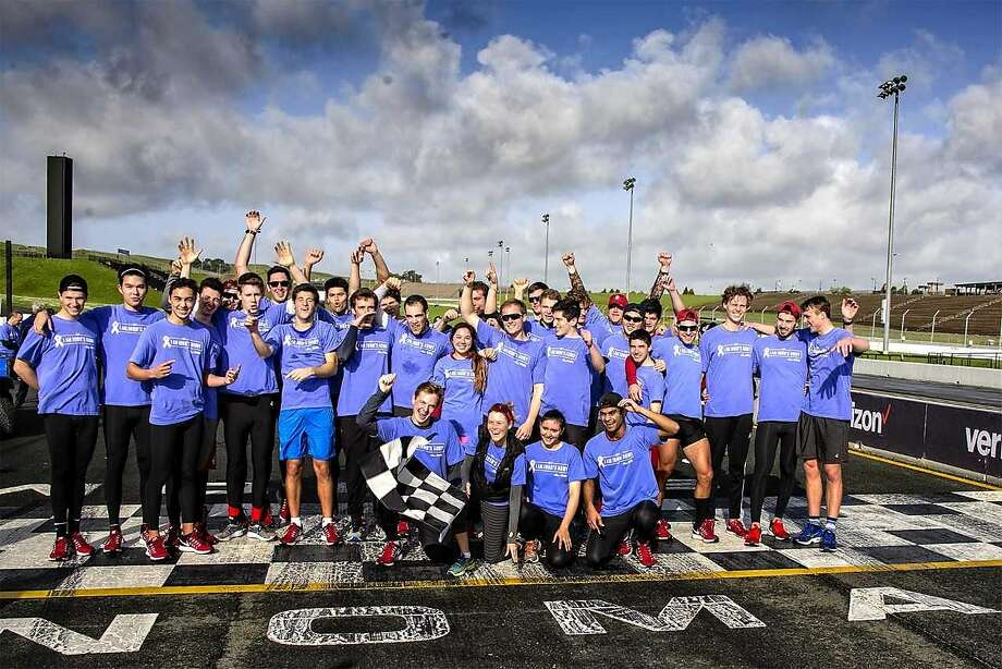 The Stanford men's rowing team gather at Sonoma Raceway after running the road course during last year's John's March, a fundraiser for stomach cancer research. Photo: Sonoma Raceway