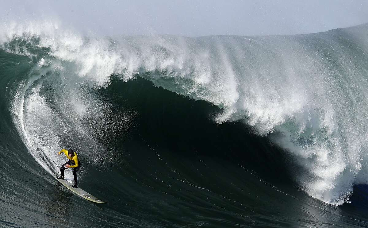 In this Jan. 20, 2013, file photo, Greg Long competes during the third heat of the Mavericks surf competition in Half Moon Bay, Calif. New organizers have gotten the go-ahead to resume the annual surf contest in the massive waves of Mavericks, with the event previously known as Titans of Mavericks now called the Mavericks Challenge, and includes women for the first time. The California Coastal Commission approved the move on Wednesday, Dec. 13, 2017. (AP Photo/Marcio Jose Sanchez, File)
