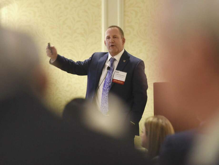 """Newmark Knight Frank Executive Managing Director Geoffrey Kasselman speaks at the Real Estate Finance Association of Connecticut luncheon at at the Marriott Hotel and Spa in Stamford, Conn. Thursday, Jan. 11, 2018. Kasselman presentated """"The Exponential Future of Everything,"""" giving examples of the fast-changing world of technology and an outlook on what the future may look like. Photo: Tyler Sizemore / Hearst Connecticut Media / Greenwich Time"""