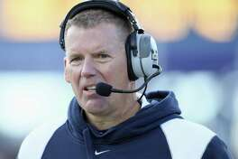 UConn football coach Randy Edsall hired a new offensive coordinator on Friday.