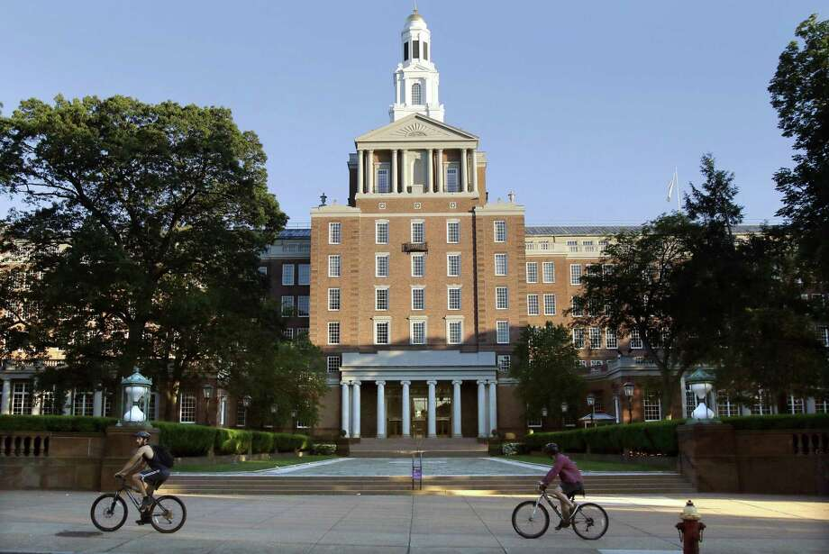 Bicyclists pedal past the Aetna headquarters in Hartford. Photo: Bill Sikes / Associated Press / Copyright 2017 The Associated Press. All rights reserved.
