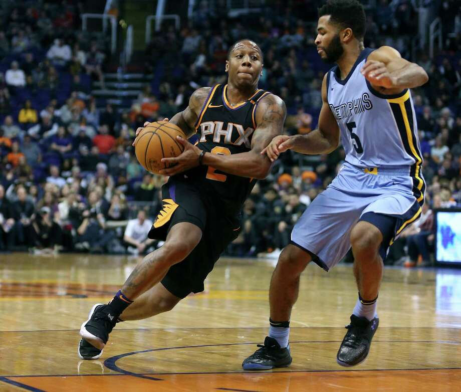 Phoenix Suns guard Isaiah Canaan (2) drives to the basket around Memphis Grizzlies' Andrew Harrison during the second half of an NBA basketball game, Thursday, Dec. 21, 2017, in Phoenix. The Suns defeated the Grizzlies 97-95. (AP Photo/Ralph Freso) Photo: Associated Press / FR170363 AP